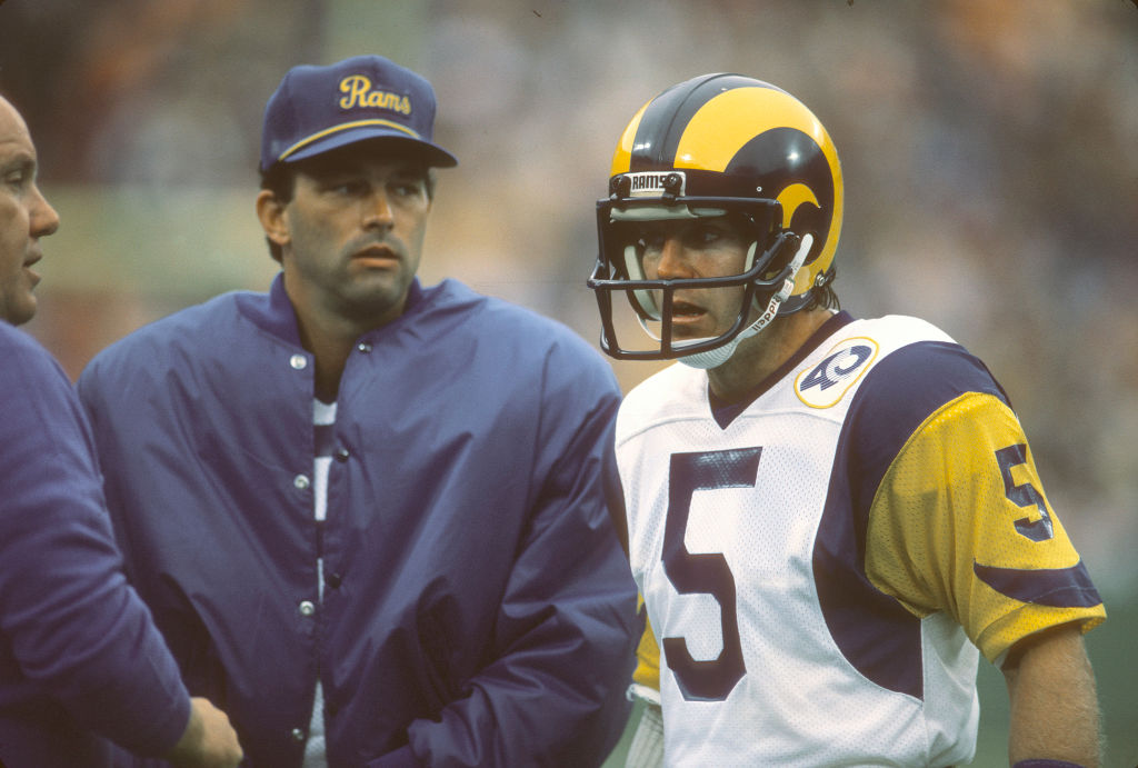 Dieter Brock of the Los Angeles Rams talks with head coach John Robinson