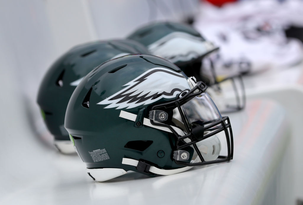 Philadelphia Eagles helmets lined up on the bench before a football game