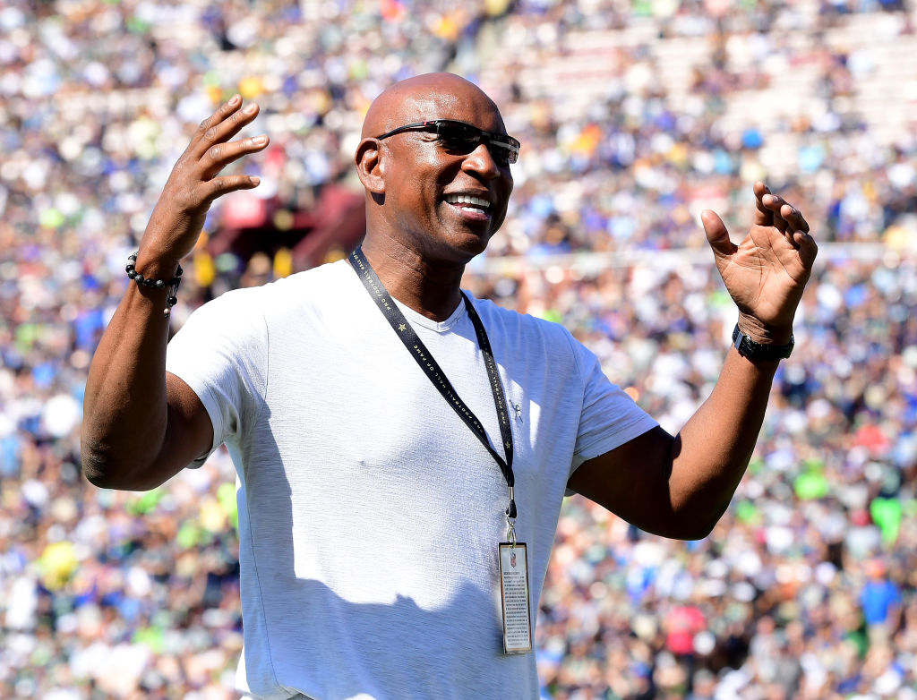 Former Los Angeles Rams Eric Dickerson laughs on the sidelines