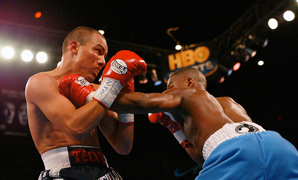 Floyd Mayweather lands a left jab to the throat of Jose Luis Castillo in 2002