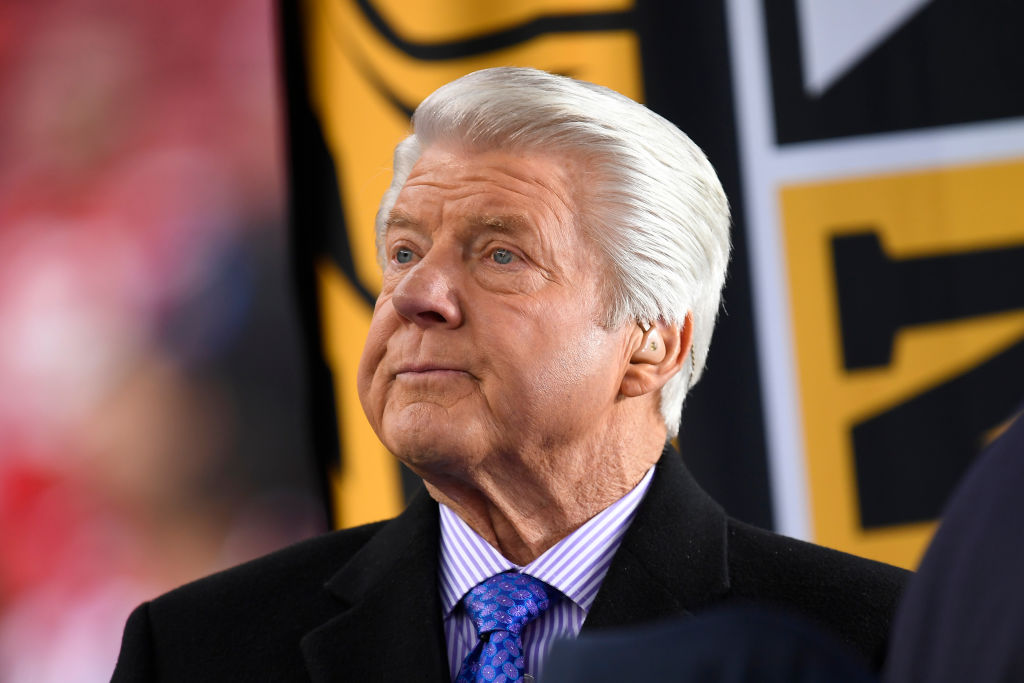 Former NFL football coach Jimmy Johnson sits in the on-field studio