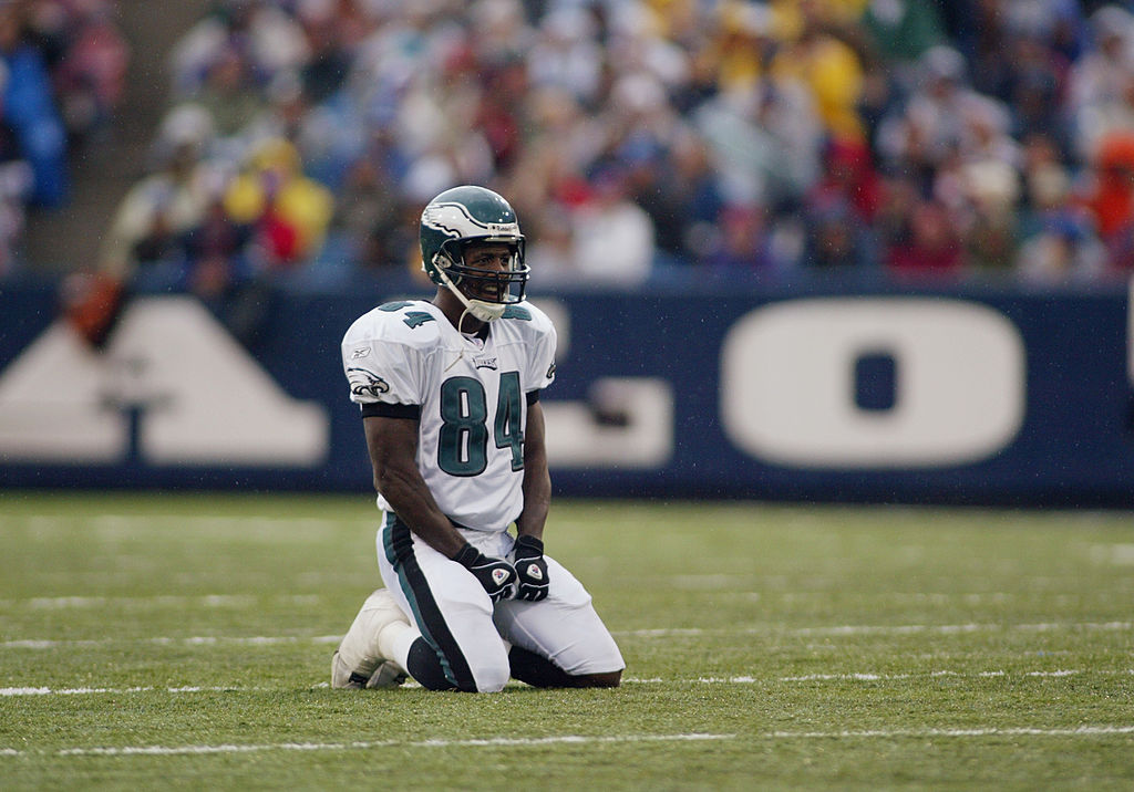 Freddie Mitchell of the Philadelphia Eagles kneels on the field
