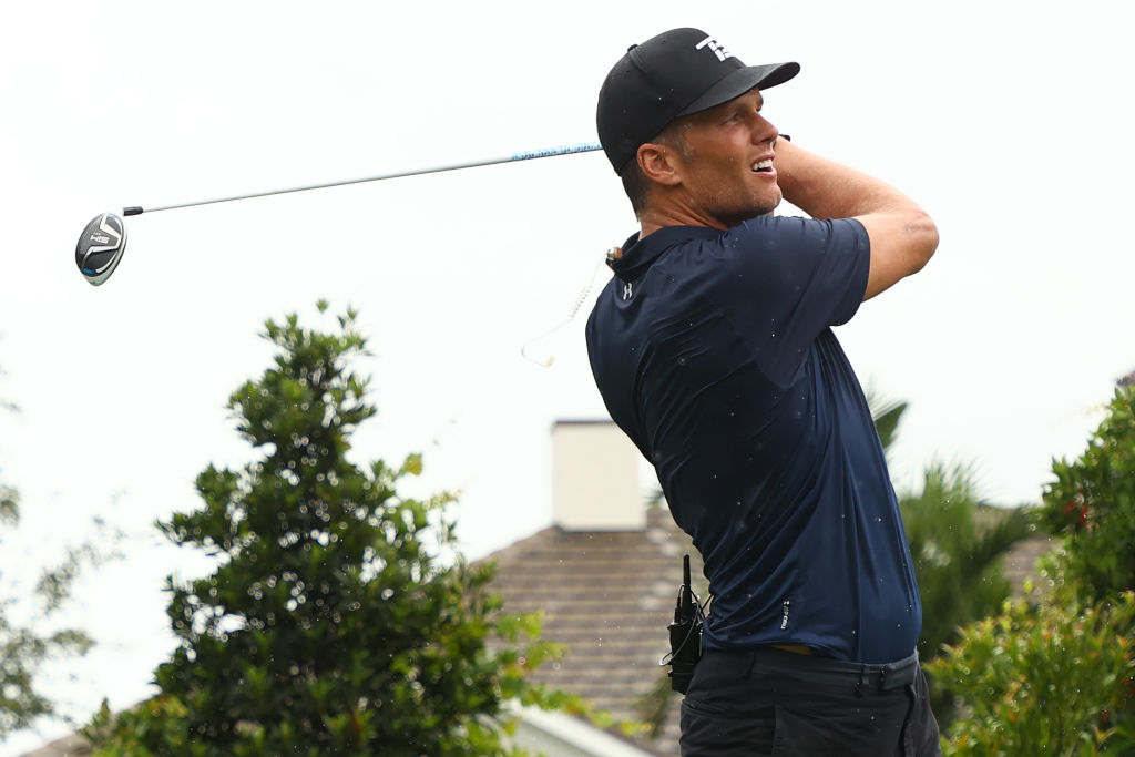 Tom Brady sent the sports world into a frenzy Sunday when he holed out an approach shot then ripped his pants reaching for the ball.
