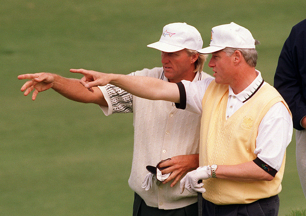 While Greg Norman was the pro on the golf course, he still learned a lesson during a round with Bill Clinton.