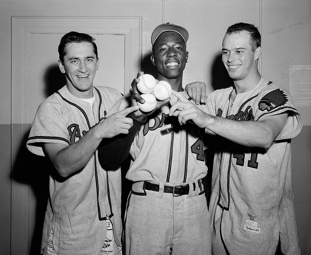 The long-ball hitters who contributed to Milwaukee's 13-hit attack against the Brooklyn Dodgers in 1956: Johnny Logan, Hank Aaron, and Eddie Mathews