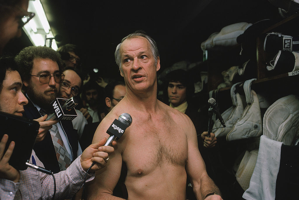 Hartford Whalers' Gordie Howe answers questions during an interview