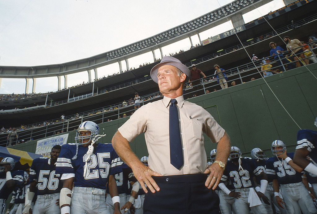 Head coach Tom Landry of the Dallas Cowboys stands with his team