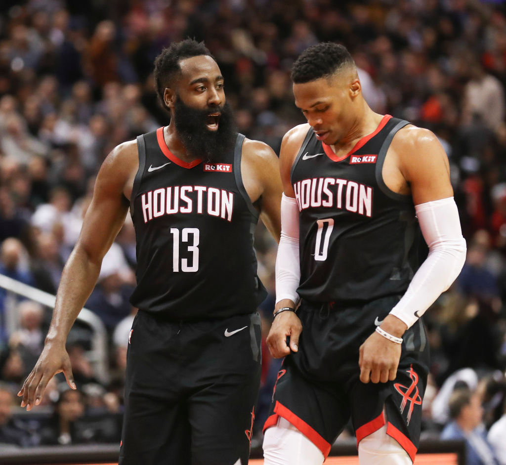 Houston Rockets guard James Harden chatswith Russell Westbrook
