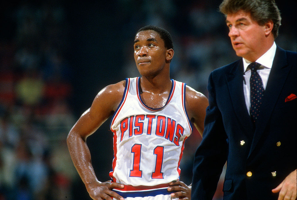 Isiah Thomas of the Detroit Pistons looks on with head coach Chuck Daly