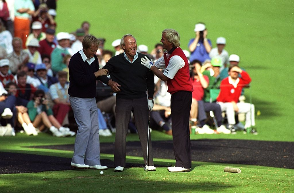(L-R) Jack Nicklaus and Arnold Palmer share a joke with Greg Norman
