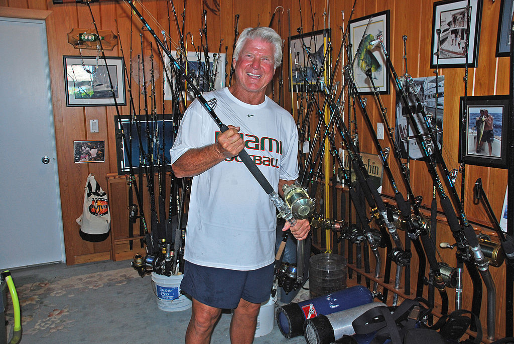 Jimmy Johnson posing with all of his fishing equipment