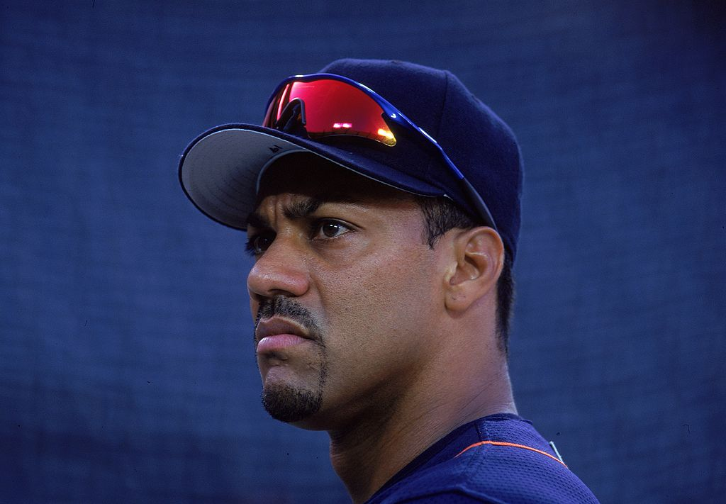 Juan Gonzalez looks on during a baseball game