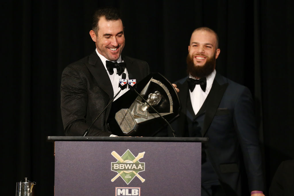 Justin Verlander of the Houston Astros receives the 2109 American League Cy Young Award from former teammate Dallas Keuchel