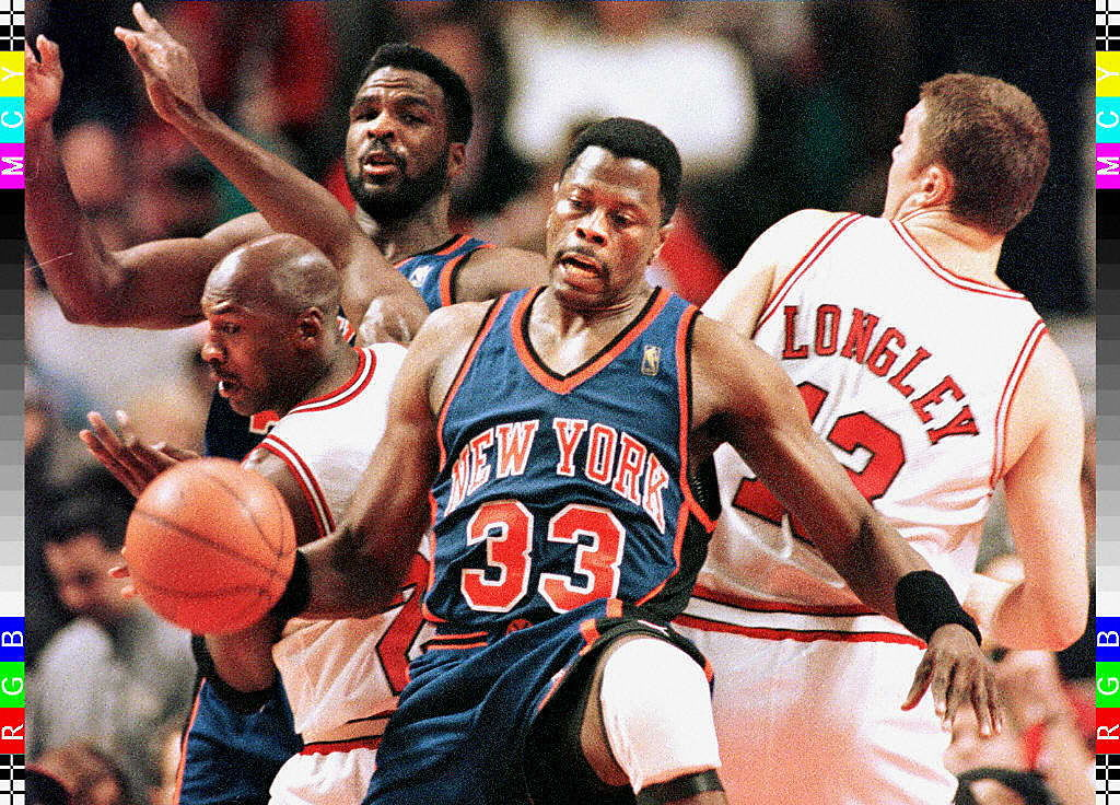 New York Knicks center Patrick Ewing holds back Chicago Bulls guard Michael Jordan
