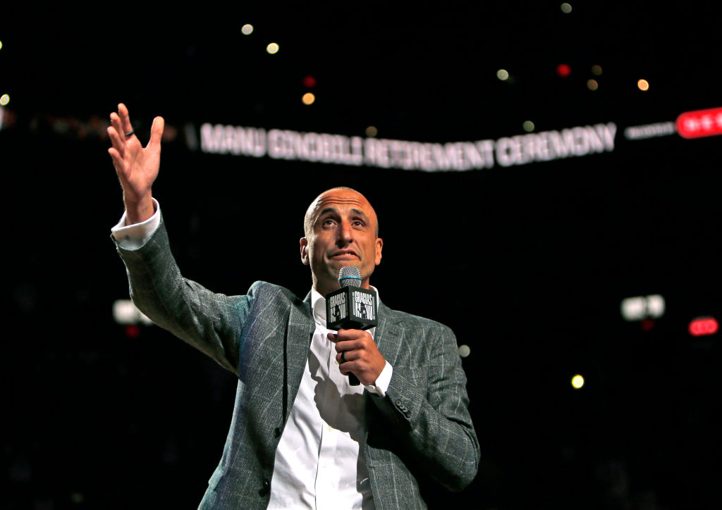 Manu Ginobili talks to fans after his number was retired