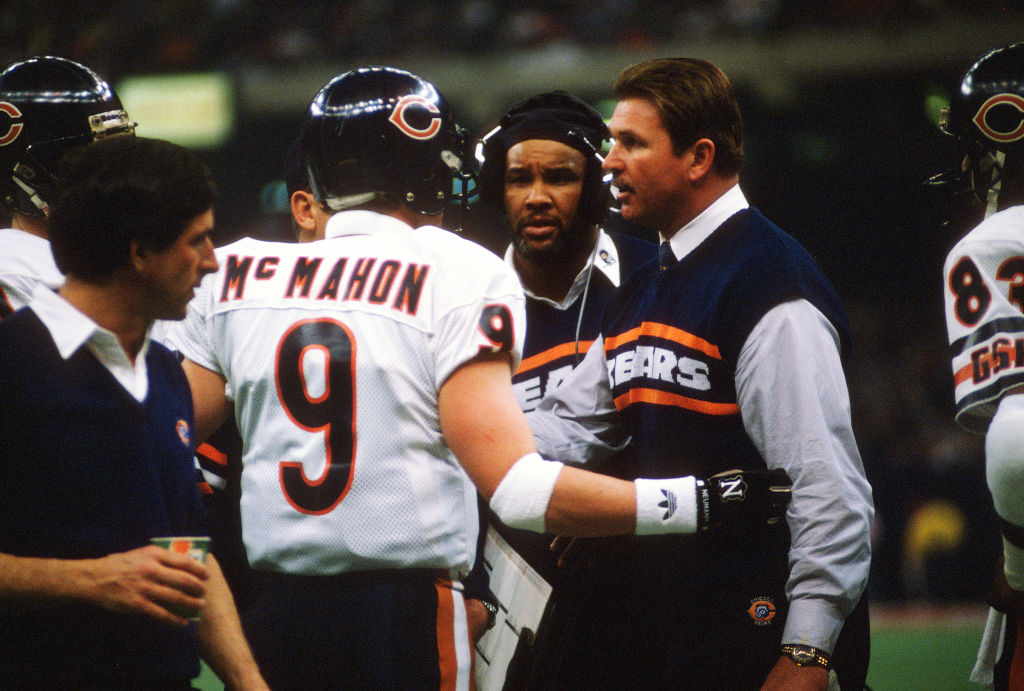 Head Coach Mike Ditka of the Chicago Bears talks with his quarterback Jim McMahon in 1986