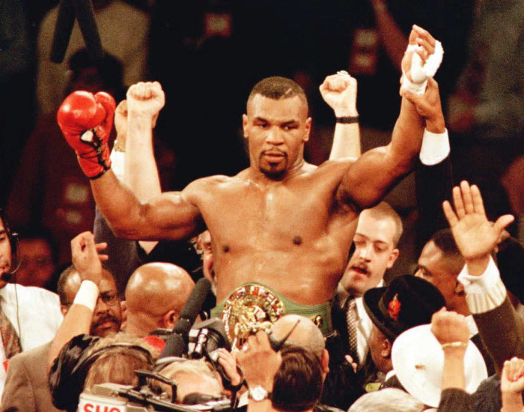 Mike Tyson celebrates a knockout win