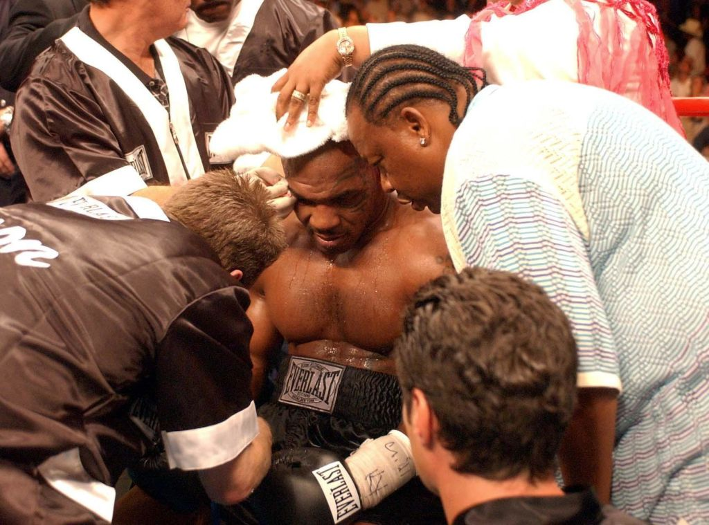 Mike Tyson in his corner after losing to Danny Williams in their heavyweight contest