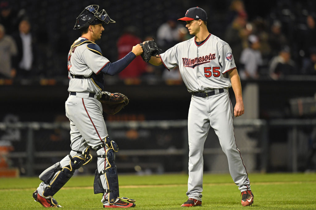 Minnesota Twins catcher Jason Castro (L) and Minnesota Twins relief pitcher Taylor Rogers