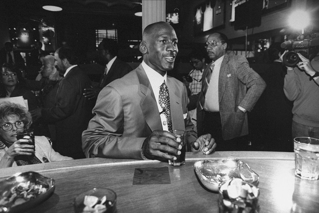 Chicago Bulls basketball star Michael Jordan holding drink