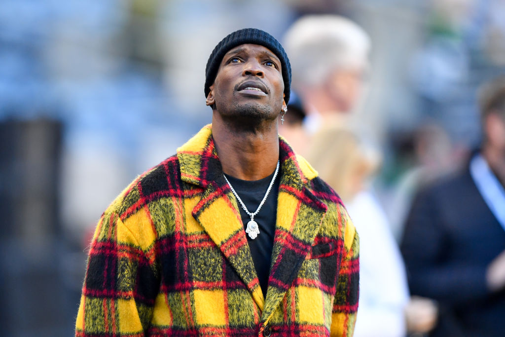 Chad Ochocinco Johnson looks up at the scoreboard during an NFL game