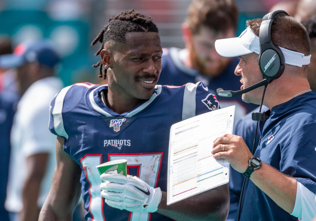 New England Patriots wide receiver Antonio Brown talks with Offensive Coordinator Josh McDaniels