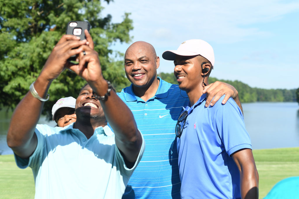 Retired NBA Player Charles Barkley poses with attendee
