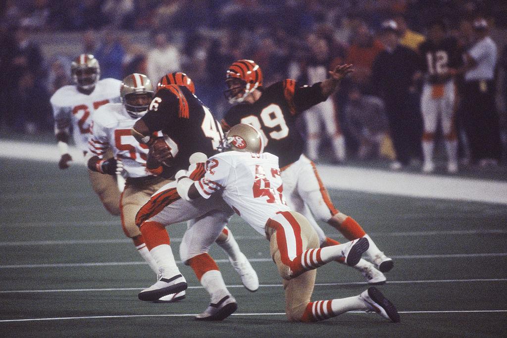 San Francisco 49ers' cornerback Ronnie Lott runs to tackle