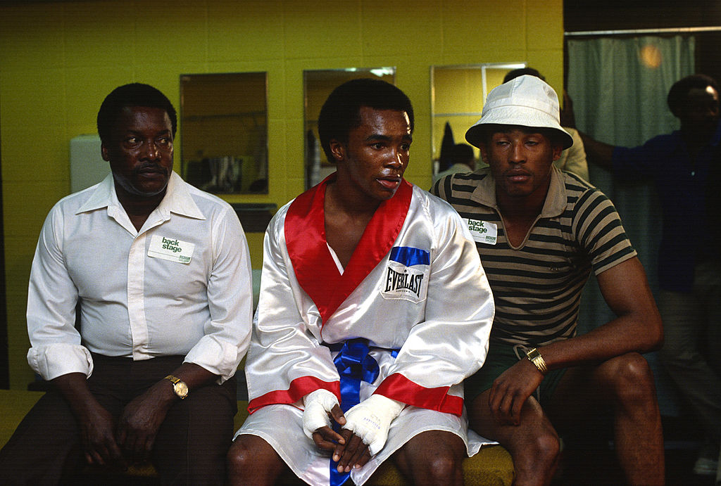 Sugar Ray Leonard (C) sits in his dressing room before a fight