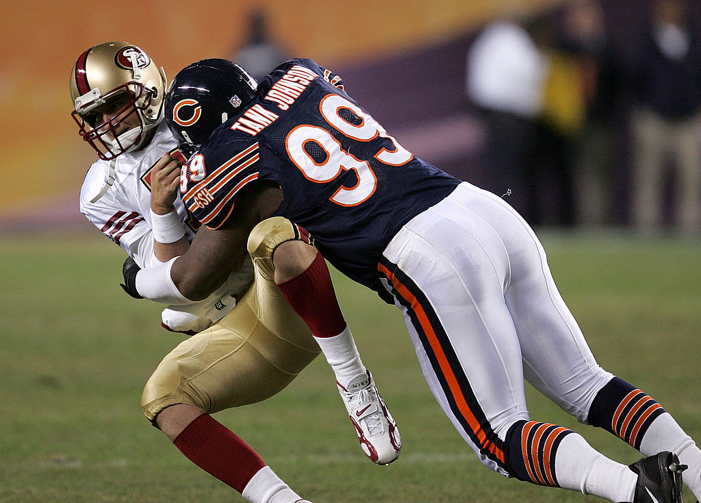 Tank Johnson of the Chicago Bears takes down Ken Dorsey of the San Francisco 49ers