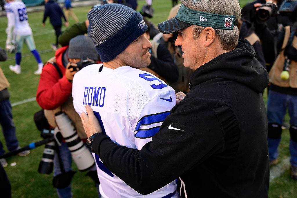 Tony Romo of the Dallas Cowboys is greeted by Doug Pederson, head coach of the Eagles in 2015
