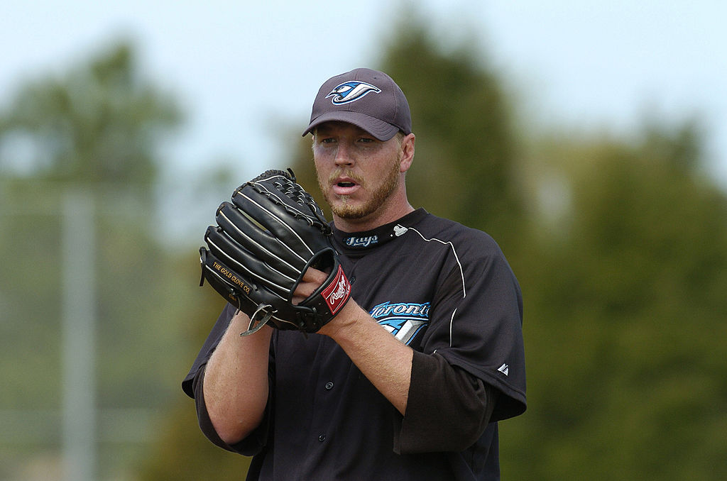 Toronto Blue Jays pitcher Roy Halladay delivers a pitch during practice in 2004