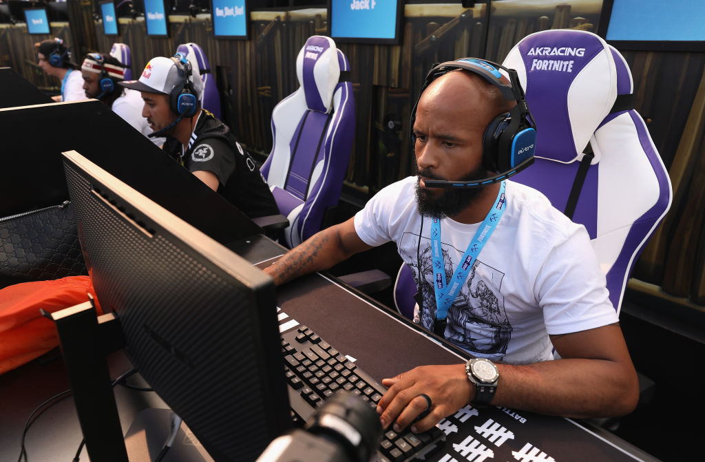 UFC Fighter Demetrious Johnson competes in the Epic Games Fortnite E3 Tournament