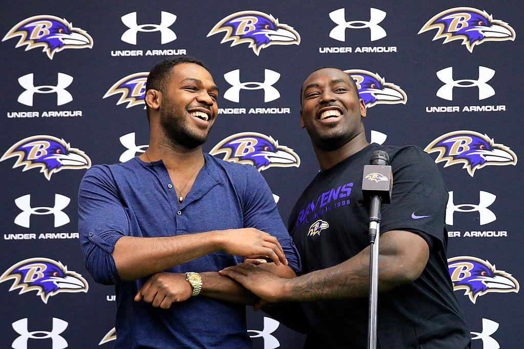 UFC fighter Jon Jones (L) jokes around with his brother defensive end Arthur Jones of the Baltimore Ravens