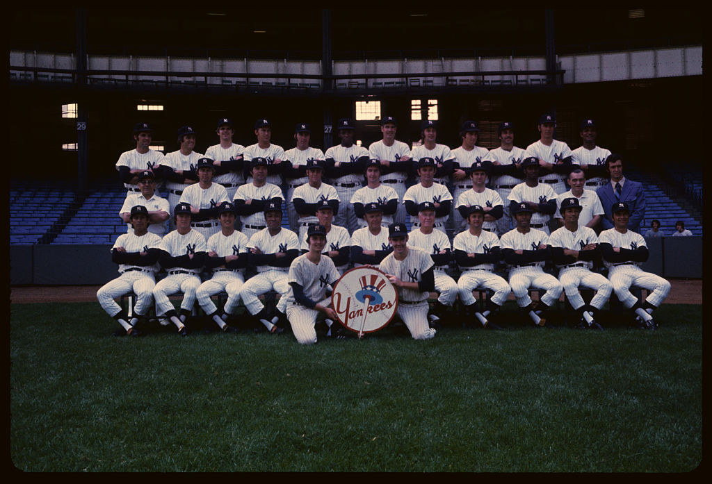 On the field, John Ellis (third row) was a journeyman catcher in the American League. Off the field, Ellis served as a bounty hunter during offseasons.