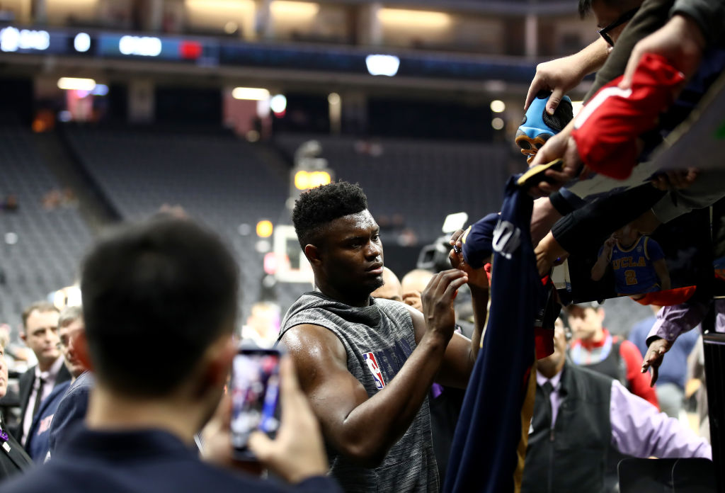 Zion Williamson of the New Orleans Pelicans signs autographs