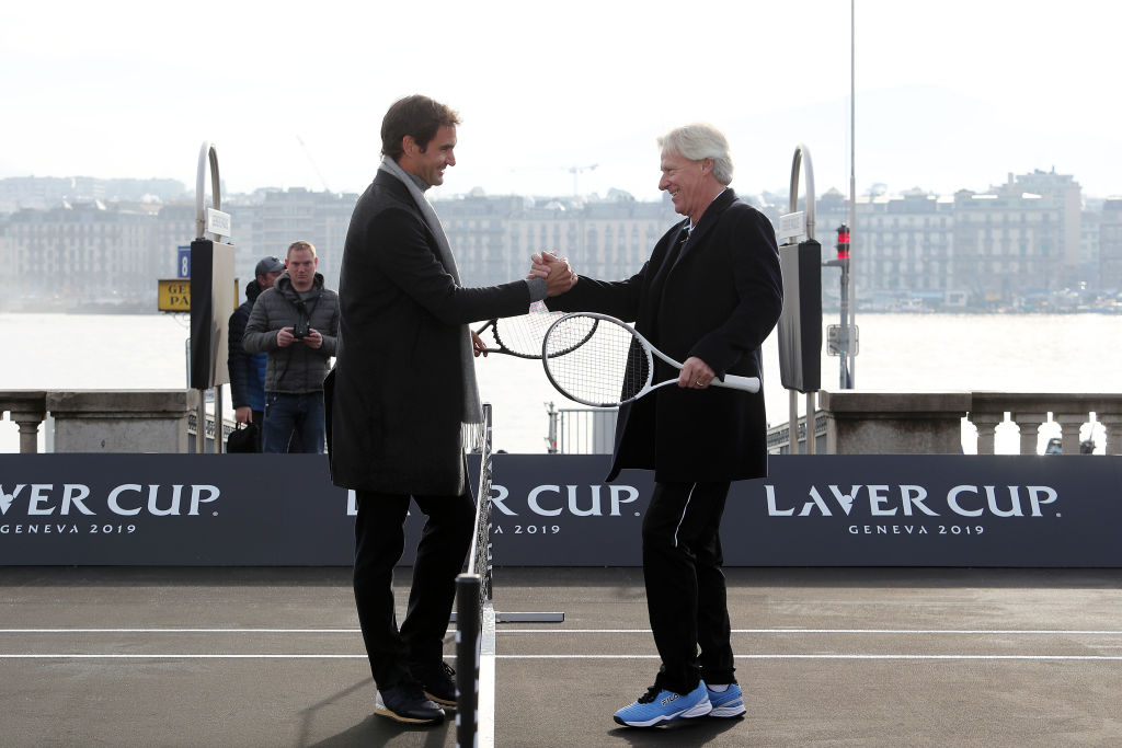 Bjorn Borg shakes hands with Roger Federer in 2019