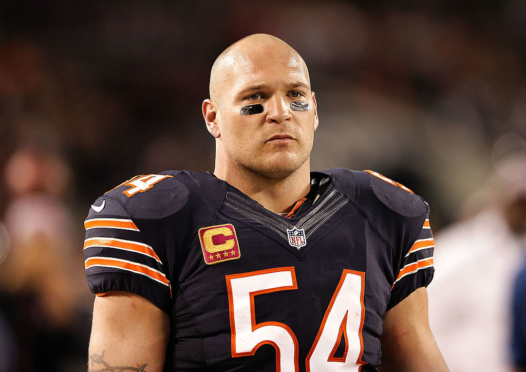 Brian Urlacher watching a Bears game from the sideline
