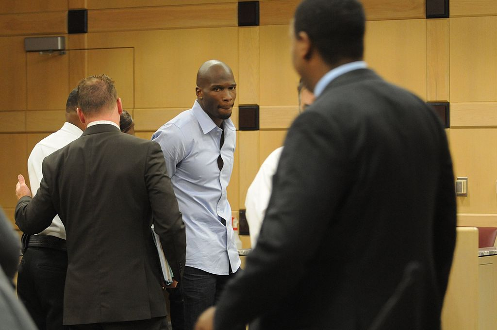 Chad Johnson in handcuffs after a court case