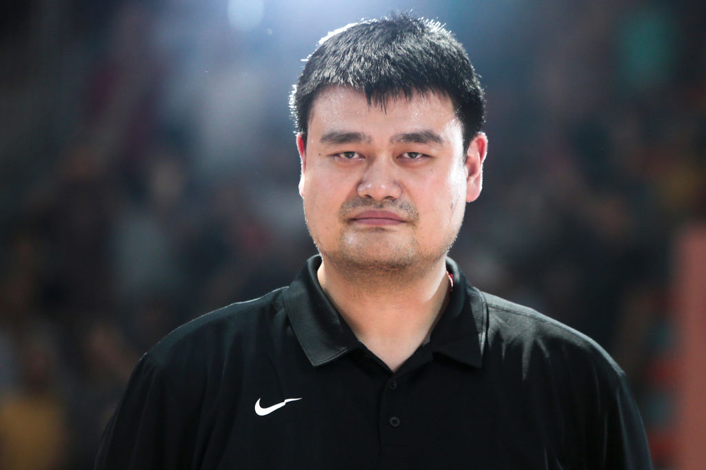 Chinese Basketball Association President Yao Ming, also the founder of Yao Foundation, looks on during an exhibition game