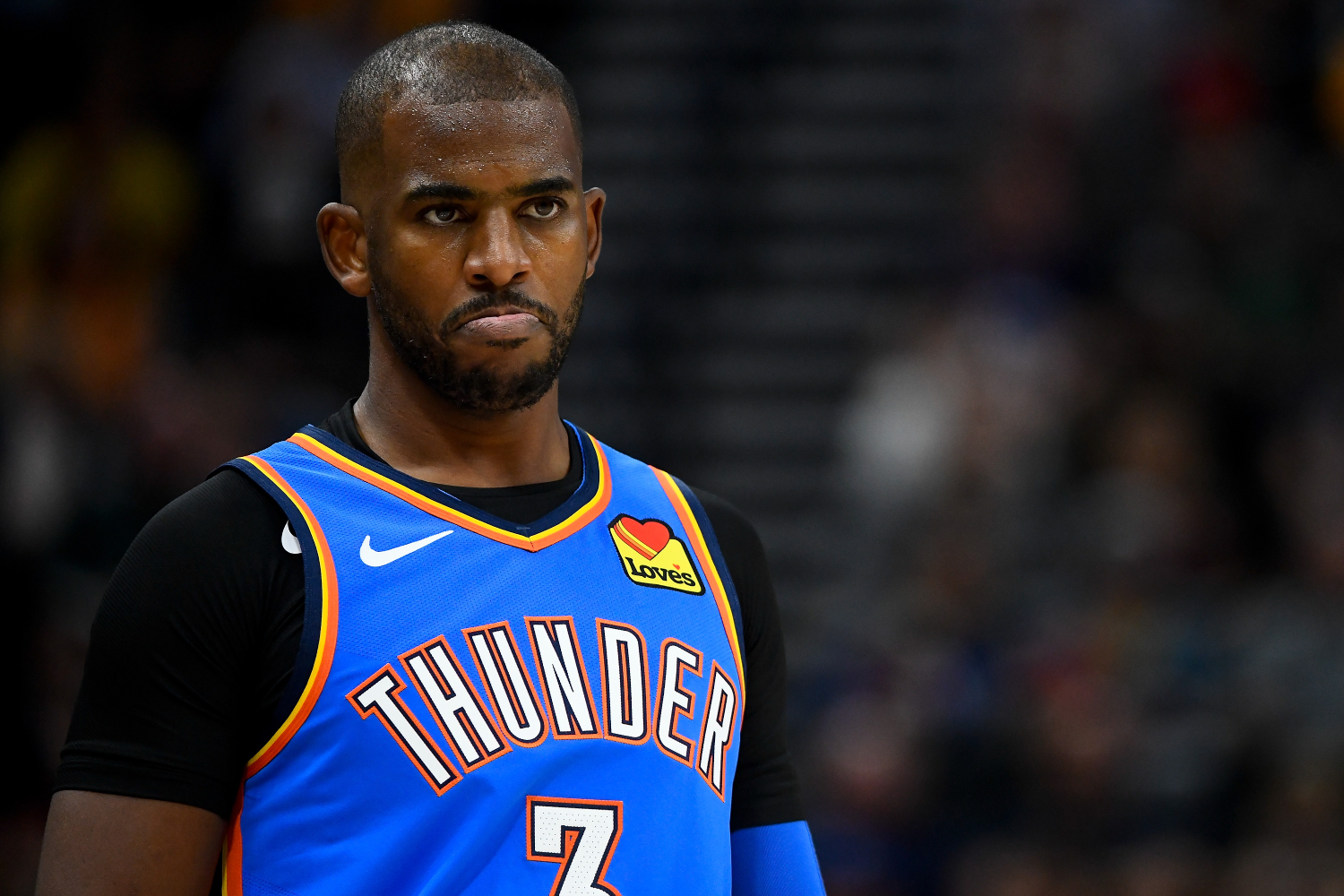 Chris Paul looks on during a Thunder game