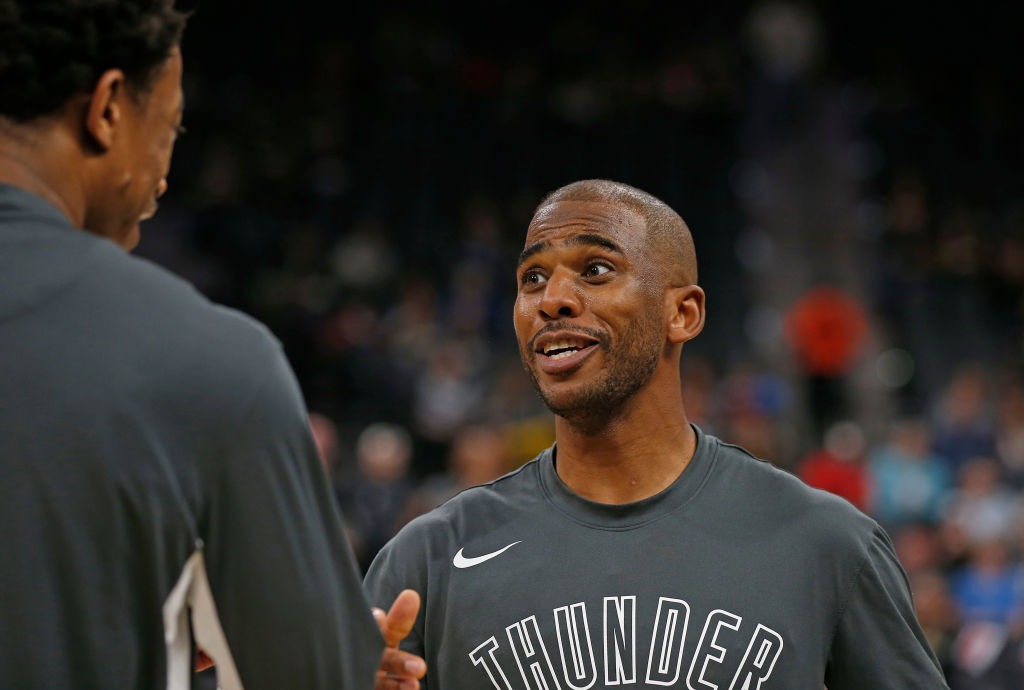 Chris Paul of the Oklahoma City Thunder chats with teammates