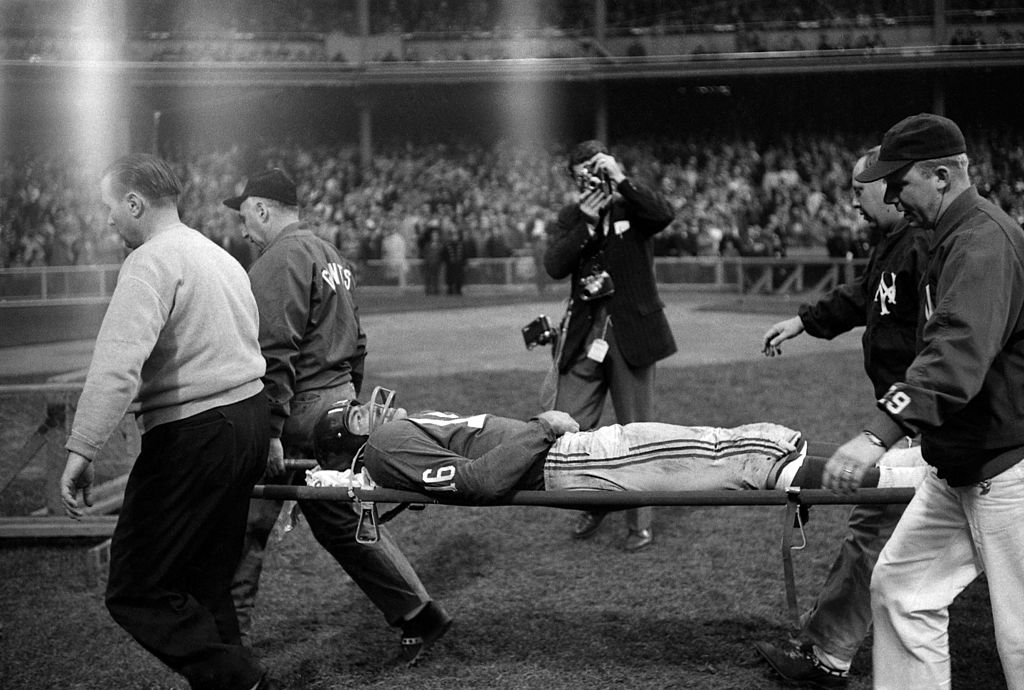 Frank Gifford is carried off the field on a stretcher after being hit by Eagles linebacker Chuck Bednarik