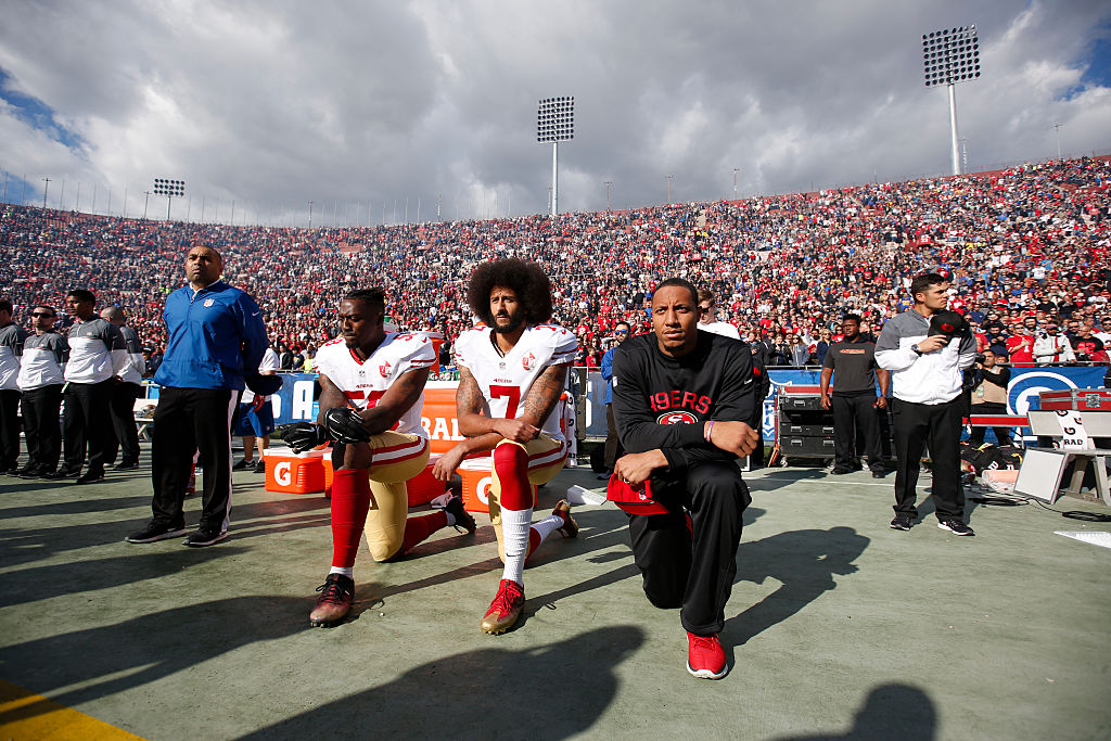 How much money has Colin Kaepernick given to charity?