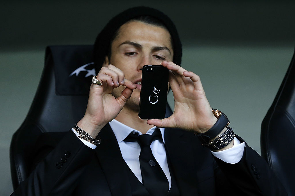 Cristiano Ronaldo takes a picture with his phone