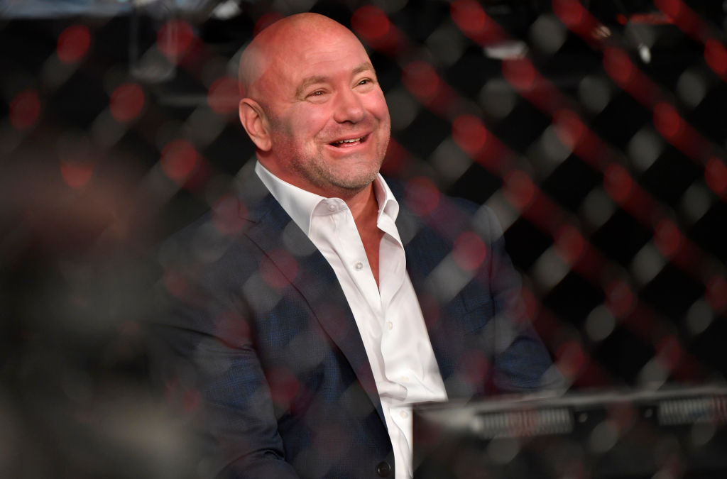 Dana White sitting next to the ring at a UFC event