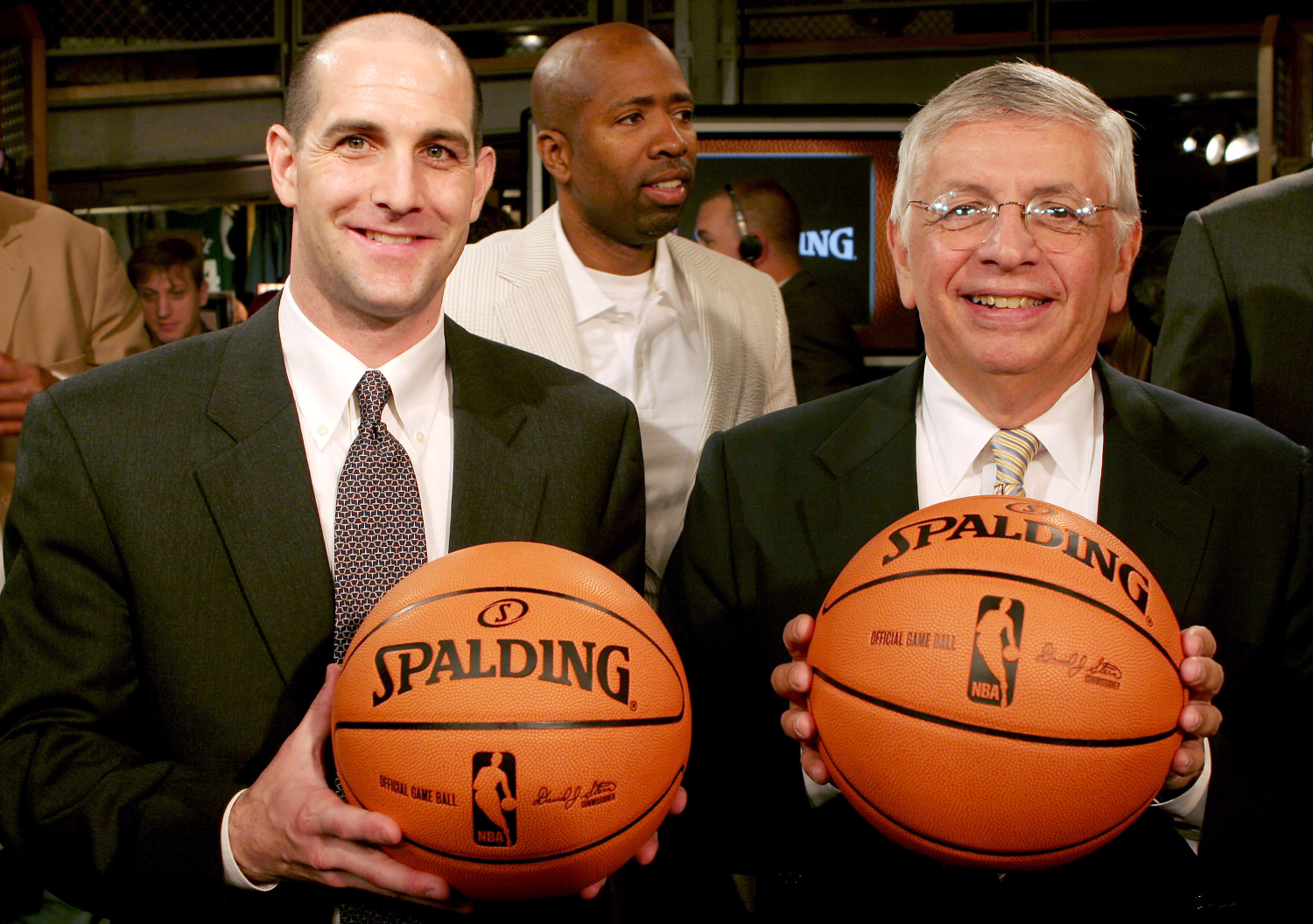David Stern posing with the NBA ball that he introduced