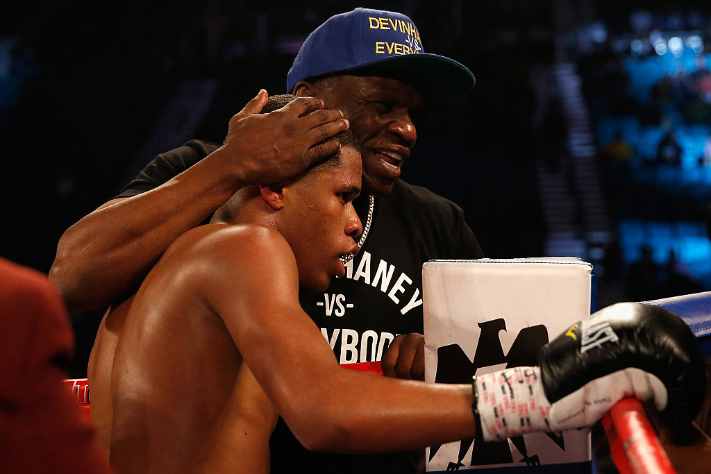 Devin Haney celebrates with his trainer Floyd Mayweather Sr. after Haney's victory