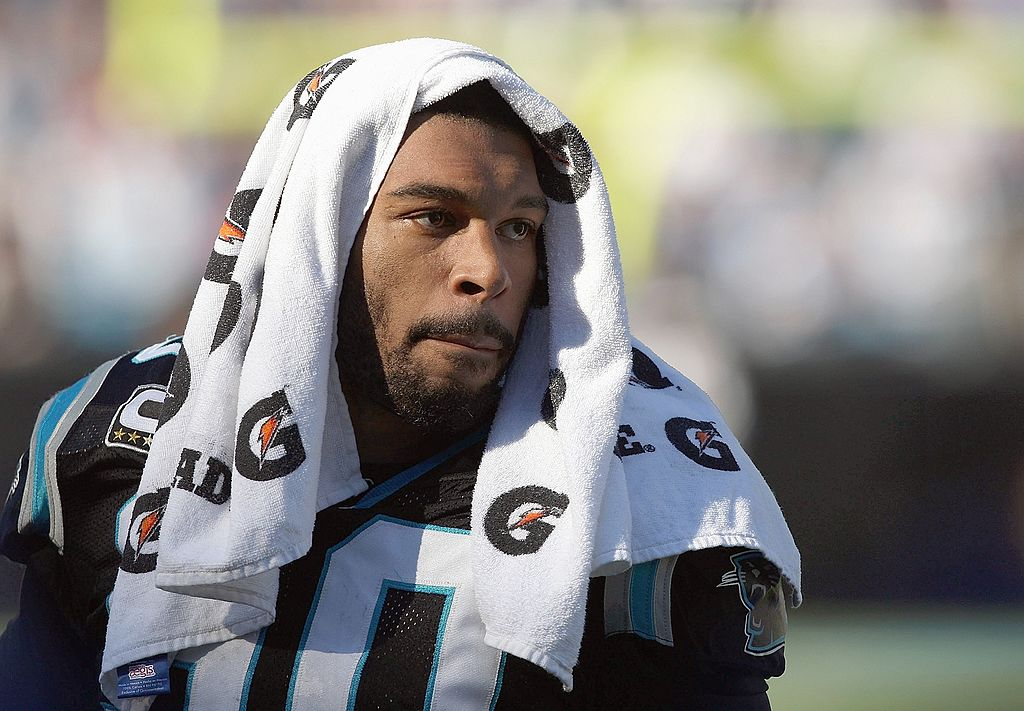 Dwayne Jarrett looks on from the sideline during an NFL game
