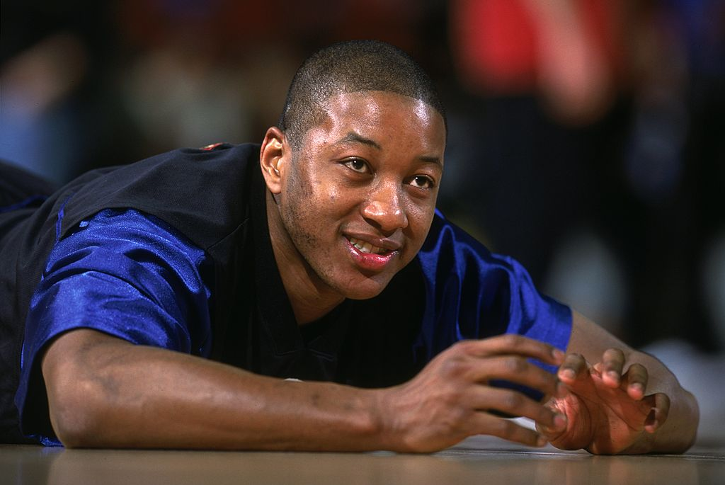 Eric Snow of the Philadelphia 76ers lays on the floor